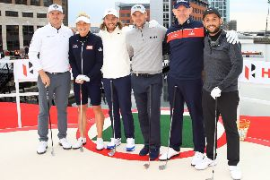 Stephen Gallacher, second right, lines up with, from left, Matt Wallace, Charley Hull, Tommy Fleetwood, Martin Kaymer of Germany and Alex Levy ahead of the Hero Challenge