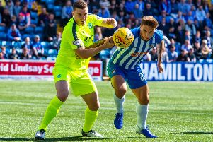 Hibs defender Paul Hanlon holds off Kilmarnock striker Eamonn Brophy