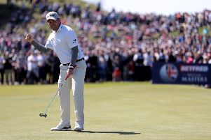 Richie Ramsay celebrates a birdie putt on the 18th hole during day four of the Betfred British Masters