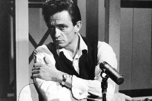 Johnny Cash ' no stranger to trouble himself ' often entertained inmates. Picture: Getty