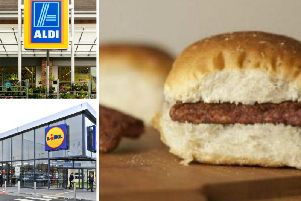 Lidl has poked fun at Aldi over a social media post about their new 'Sausedge' product which sparked an online backlash. Pictures: Naomi Vance/ Shutterstock Cristina Nixam (Aldi) and Vytavitas Kielaitis (Lidl)