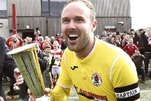 Johnny Stewart celebrates after winning the East of Scotland League title