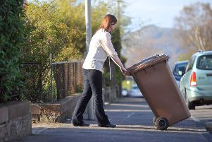 Pictured is a garden waste bin being placed out for collection. Pic: Jane Barlow
