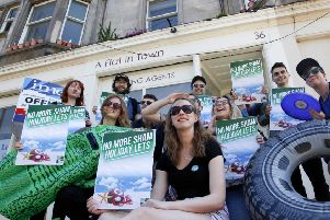A protest against holiday lets outside letting agency A Flat in Town