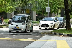 Driverless cars, such as the one pictured left,  have been found to improve traffic flow. PIC Roslan Rahman/AFP/Getty Images.