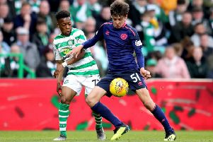 Hearts' Aaron Hickey and Celtic's Karamoko Dembele impressed. Pic: SNS