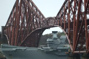 HMS Queen Elizabeth lowered her pole mast to fit under the bridge en route to Rosyth. Pic: Katielee Arrowsmith/SWNS