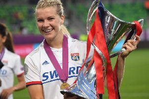 Ada Hegerberg celebrates with the trophy after her team Lyon beat Barcelona 4-1 in the UEFA Women's Champions League final in Budapest. Picture: AFP/Getty
