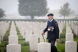 Normandy veteran Edwin 'Ted' Hunt walks past the graves of fallen in 2018. Picture: Getty