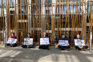 The five protesters outside the Scottish Parliament today