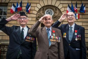 D-Day veterans Jack Adamson, David Livingston and Robert Jobson Paton outside the French Consulate