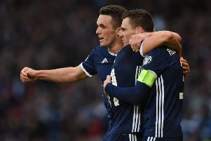 Scotland's John McGinn celebrates with Andy Robertson after the latter put the Scots ahead against Cyprus. Pic: SNS