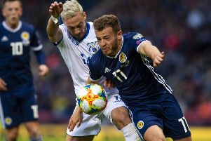 Ryan Fraser gets ahead of Antreas Makris of Cyrpus in their Group I clash at Hampden Park on Saturday. Pic: SNS