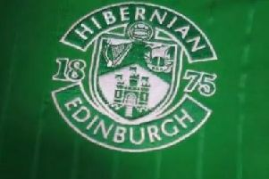 The Hibs badge on the new home kit.