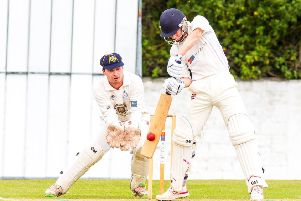 Grange batsman Scott Blain is forced to fend off a spinning bowl from RH Corstorphine's Majid Haq