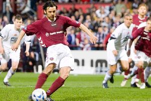 Paul Hartley's converts one of his most important penalties in his Hearts career. Picture: SNS