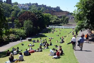 A short hot spell will see the mercury climb across the country. On Thursday Edinburgh residents basked in the sunshine in Princes Strett Gardens (pictured) Picture: TSPL
