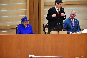 Queen Elizabeth II listens to Ken Macintosh, Presiding Officer of the Scottish Parliament, as she attends a ceremony to mark the 20th Anniversary of the Scottish Parliament. Picture: Jeff J Mitchell - WPA Pool/Getty Images.