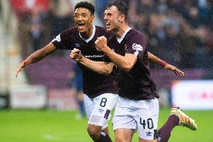 Andy Irving wheels away after equalising for Hearts