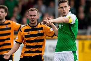 Paul Hanlon will likely start at the back for Hibs