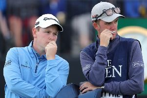 Bob MacIntyre (left) speaks to his caddy whose muother was hit by one of  Kyle Stanley's wayward shots
