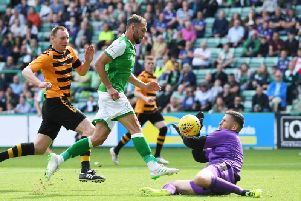 Christian Doidge chips the ball over the onrushing Alloa 'keeper Neil Parry to net Hibs' first goal