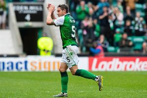 Mark Milligan applauds the fans as he is substituted in his final appearance for Hibs