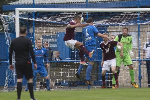 Ian Black opens the scoring for Tranent against Newtongrange with this header. Pic: TSPL