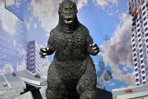Godzilla wouldn't make it past the Foot of the Walk ' the pavements are too hazardous even for him to negotiate. Picture: AFP/Getty