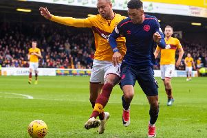 Charles Dunne and Sean Clare battle for possession the last time Hearts faced Motherwell at Fir Park.