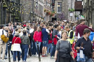 Tourists pack the Royal Mile during the Festival. Picture: Ian Rutherford