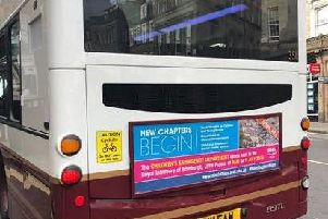 A row has broken out over the date this image - showing a Lothian bus displaying advertising for the new Sick Kids hospital opening on July 9 - was taken.