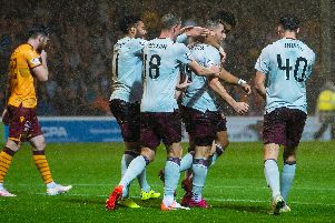 The Hearts players celebrate Conor Washington's goal.