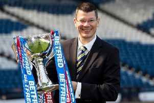 SPFL chief Neil Doncaster with the Betfred Cup trophy.