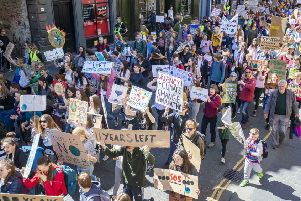 School pupils taking part in a climate strike march to Holyrood. Picture: Jane Barlow/PA,