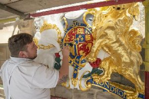 The kirk's coat of arms has been restored.