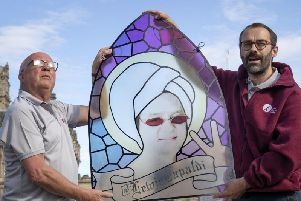 Centre manager Peter Law (right) and his assistant Malcolm Moore take a closer look at a stain-glass window that features Scottish singer-songwriter Lewis Capaldi. The window will be on display in the Scottish Twitter Visitor Centre at the Edinburgh Fringe.