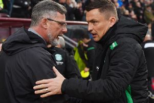 Hearts and Hibs fans want their managers to sign a striker. Picture: SNS