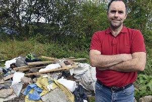 Robin Traquair next to the latest pile of waste