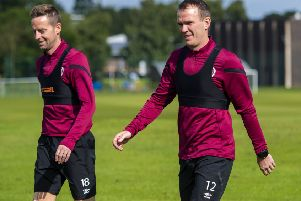 Glenn Whelan, right, is likely to feature for Hearts against Celtic. Pic: SNS