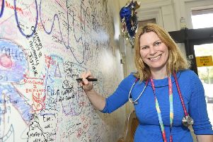 Mairi Stark, a member of the Royal College of Paediatrics and Child Health and lead for general paediatrics, pictures by the wall of farewell messages. Pic: Greg Macvean.