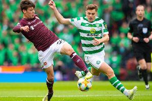 Aaron Hickey in action against James Forrest