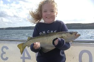 Mya Scott with her biggest fish, a 4lb cod.