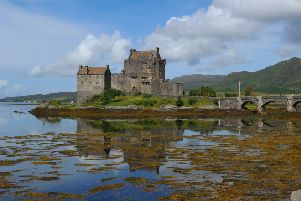 Man falls 20ft from rocks trying to take picture of Scottish castle