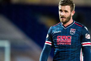 Jason Naismith in action for Ross County