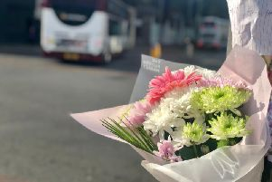 Floral tributes and messages laid at foot of Leith Walk after 62-year-old tragically died