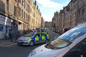 Police set up a road block on Yeaman Place on Saturday afternoon.