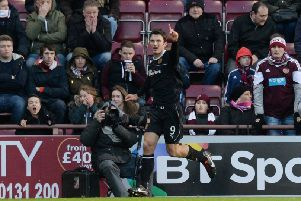 John Sutton scores against Hearts back in 2014. Picture: SNS