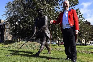 Alistair Campbell, current captain of the Honurable Company of Edinburgh Golfers, with the statue of John Rattray