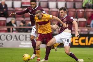 Hearts' Jake Mulraney, left, tries to win possession. Pic: SNS